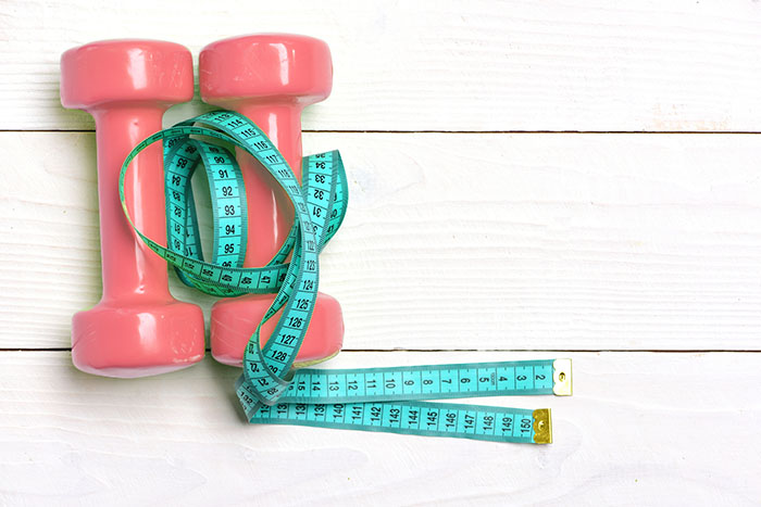 dumbbells-and-measuring-tape