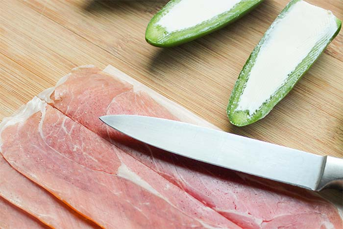 Keto Prosciutto-Wrapped Jalapenos - cut prosciutto lengthwise